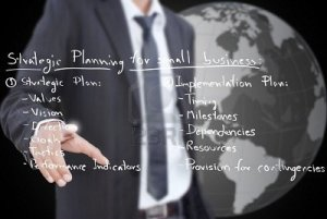 Whiteboard--business man-strategic-planning-on-the-whiteboard